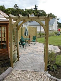 An arch creates the perfect entrance to patio area and summerhouse.
