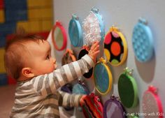 BABY SENSORY WALL  Use different textured fabrics and cross stitching looms to create circles for babies to feel.