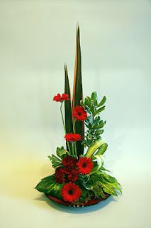 japanese style flower arrangement. tropical flowers. ikebana