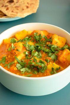 batata rassa is a gujarati curry garnished with coriander