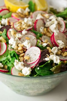 Whimsical Spring salad...radishes, green beans, blanched, yellow or white corn, baby heirloom tomatoes or cherry tomatoes, halved,goat cheese,toasted pine nuts,spring mix greens and arugula seasoned with freshly squeezed lemon juice,salt and pepper to taste