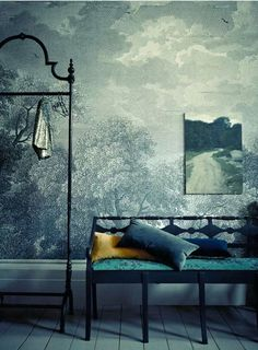 BLUE SKY CALLING   The 'Etched Arcadia' wallpaper mural from Anthropologie is the backdrop to this rich blue hallway. Add layers of similar colours and luxurious textures to create a dramatic look.      http://www.anthropologie.com/anthro/product/home-wallpaper/23766900.jsp  (The wallpaper says Towering trees and an endless sky cover your wall in graphite-hued forestry; not sure if the designer did a blue wash to the wallpaper or not.)