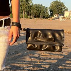 Our upcycle bike inner tube Whitney clutch is hanging out, enjoying the beach.  www.evenodd.us