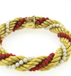 1960s Red Coral Pearl Gold Bracelet | From a unique collection of vintage more bracelets at https://www.1stdibs.com/jewelry/bracelets/more-bracelets/