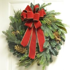 Designer Faux Christmas Wreath with Red Ribbon CR1041 - Deck the halls this holdiay season  using our gorgeous realistic looking pine wreath decorated with cones, magnolia foliage and large handtied red bow. 24""