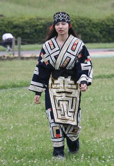 An Ainu woman in a traditional costume walks during a ritual ancestor worshipping ceremony on a river bed in Tokyo Japan on Sunday April 8 2008...