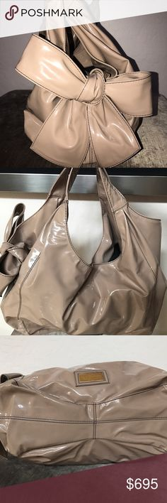 """Valentino Nuage large hobo bag Valentino Nuage nude patent leather bow hobo handbag. Great condition, very clean. 15""""L x 10"""" H x 7""""D. Shiny patent nude w giant box soft unstructured. Front Valentino logo plate (still has plastic over it) no scratches. W magnetic snap closure 2 interior compartments & a zippered large pocket. Made in Italy. Comes w original duster bag. Valentino Bags Hobos"""