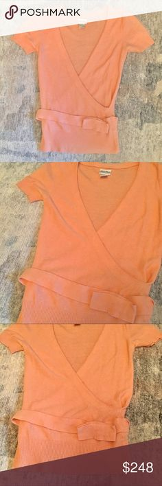 Tracy Reese Soft Coral Knit Wrap Top Sz P Tracy Reese Soft Coral Knit Wrap Top Sz P. Fits like a ✨Small✨. Beautiful wrap shape with thick knit belt strung around the waist. Folded over belt accent. Angora cashmere wool viscose and nylon fiber blend. Ultra soft and perfect color for transitioning between summer and fall. Tracy Reese Sweaters