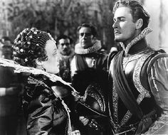 Errol Flynn and Bette Davis in The Private Lives of Elizabeth and Essex. Bette plays Queen Elizabeth I and required an enormous amount of Joseff  Hollywood jewelry plus Joseff made all the ornaments that were sewn onto her beautiful gowns.