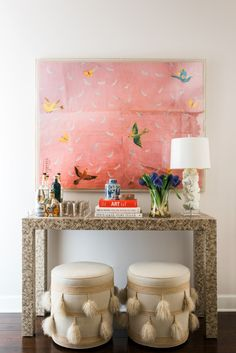 Stunning entryway with console table and oversized artwork