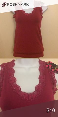 NWT Burgundy Lace Tank Top Tag read FREE SIZE- would beat fit a XS/S. Burgundy colored lace tank. 92% nylon and 8% spandex. Very stretchy! MAKE AN OFFER! Boutique Tops Tank Tops