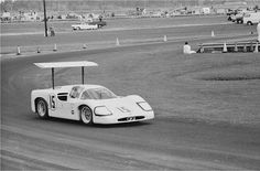 Phil Hill practices at Sebring in the newly reworked Chaparral 2F. For Sebring, the radiator vents were redesigned, as was the back deck, eliminating the large Plexiglass window. Unlike at Daytona, the wing was now controlled by the drivers. Albert R. Bochroch photo.