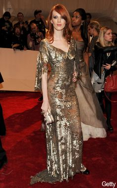 Karen Elson wearing the silver gown she had modelled for Lee McQueen at the Met Ball