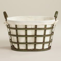 Made of metal with a patina finish, our Skyler Metal Laundry Basket is an attractive solution for carrying loads to and from the washer. Featuring a rustic wood bottom, this stylish and versatile basket also makes a fun storage option anywhere in the home.