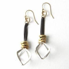 Rombo Earrings, made from a mix of sterling silver, oxidized silver, and brass,