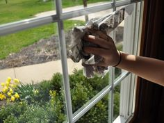 Mix 2 cups hot water with ¼ cup vinegar & 1 TBS of cornstarch, shake in spray bottle & spritz the windows, then wipe down w/ crumpled newspaper. Unlike paper or cloth towels, newspaper is absorbent without leaving lint behind. This homemade window wash solution w/ newspaper works like NOTHING else for PERFECTLY CLEAR windows!