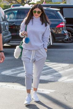 Kylie Jenner wearing Fendi Pom-Pom Bag Charm, Adidas Tubular Defiant Shoes in Core White, Dior Square Abstract Sunglasses in Havana Green and Les Petits Joueurs Mini Alex Eyes Fur Bag