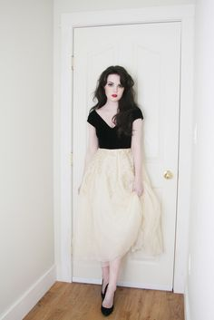 Life In Red Lipstick. Black and creme dress