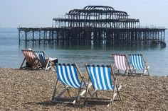 size: Photo: Deckchairs on the Pebble Beach Seafront with the Ruins of West Pier Brighton England by Natalie Tepper : Brighton England, Outdoor Chairs, Outdoor Decor, Pebble Beach, Framed Artwork, Building, Catalog, Meet, Posters