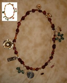 """Vikings of Bjornstad: Jack's reproduction of a crystal and red carnelian necklace found in a late ninth century Swedish site. Among the """"charms"""" are a Khazar ornament and an English book mount"""