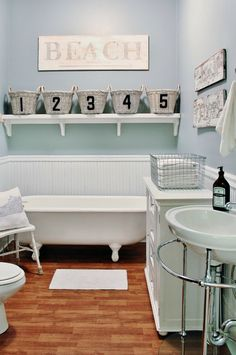 """This would be my dream bathroom ... But switch """"beach"""" for a non-ocean phrase. Love th bead board and colors!"""