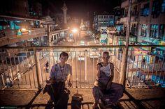 Old men listening radio on the street bridge at Yangon , Myanmar.