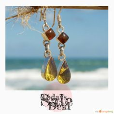 Today Only! 15% OFF this item. Follow us on Pinterest to be the first to see our exciting Daily Deals.  Today's Product: Sale -  Dominican Blue Amber Dangle Earrings Sterling Silver Teardrop Diamond Caribbean Dream Green Purple stone 925 OOAK.  Buy now: https://orangetwig.com/shops/AABCLyV/campaigns/AACI4eY?cb=2016003&sn=MyBeachStore&ch=pin&crid=AACI4d5&exid=266660..
