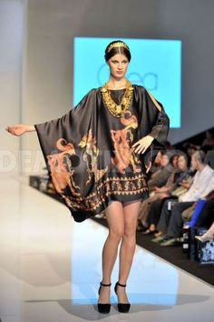 A model showing-off Indonesian designer Ghea Panggabean's fashion label at the Kuala Lumpur Fashion Week Ready to Wear 2014. Love the wonderful wayang incorporated into this design.