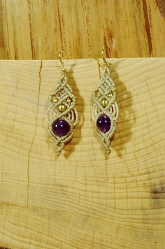 VISIT US ON WWW.LAPISZULIA.COM Beautiful handmade macrame earrings with high quality brass beads and amethyst. CHOOSE YOUR EARHOOKS Brass or gold filled (additional charge 4 €). . For our macrame jewelry we generally use waxed string, that is waterproof, fade-resistant and feels good on