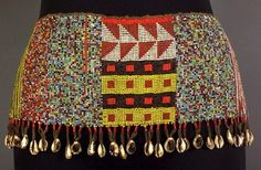 This apron was made by the Kirdi people of Northern Cameroon. Often times the only garment worn, these aprons were a symbol of womanhood and were meant to protect a woman's sex organs, which, it is believed, are particularly vulnerable to the intrusion of evil spirits. The cowry shell was once used as currency and connotes ideas of wealth and fertility.