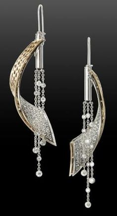 MJSA Award Winner: Annie K Jewelry in Louisville, Kentucky, for her Diamond Wave earrings, which feature curved strips of 14k yellow and white gold that naturally rotate as they are worn.