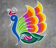 Latest Peacock Rangoli designs for Diwali they use blue, green, red, yellow and purple color to make this beautiful rangoli and highlight this rangoli with white colors Easy Rangoli Patterns, Rangoli Designs Peacock, Easy Rangoli Designs Diwali, Rangoli Simple, Indian Rangoli Designs, Simple Rangoli Designs Images, Rangoli Designs Latest, Free Hand Rangoli Design, Rangoli Border Designs