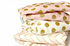 These beautiful modern crib sheets or changing pad cover will add a little glam to your nursery. Golden metallic dots shimmer beautifully, dont