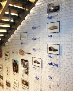 Print and installed with acrylic wall mounted stairwell timeline graphics for the Size Shoe Store in Leeds