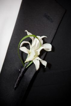 I like to match the grooms Boutonnière with an appropriate flower that's also in the bridal bouquet. There are traditional bouquets that are made with ...