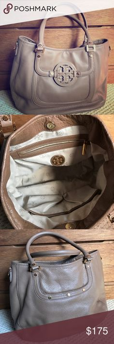 """Authentic Tory Burch Amanda Authentic leather Tory Burch Amanda in Cafe color with gold hard ware. Size 13x10x4.5 and drop strap at 7"""" This is in great condition missing long straps. 2 inside pockets and one zipper pocket. Out side has hidden front pocket under emblem and one back pocket. Tory Burch Bags Shoulder Bags"""