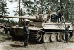 """21 June 1943 Soviet Union, on Lake Ladoga - Tankers loading a Panzer VI """"Tiger I"""" with new shells.; PK Lfl 1 Schwere Panzer-Abteilung 502 (only unit ever near Ladoga)"""