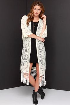 """Your gypsy soul is wild and free, that's why you and the Fields of Flowers Cream Lace Kimono Top are meant to be! Lovely sheer crocheted lace constructs this elegant kimono top with wide short sleeves, and an open front that cascades to a midi-length. Knotted fringe trims the bottom hem for a fully Boho look. Unlined and sheer. Fringe measures 9"""" long at bottom. Self: 70% Cotton, 30% Polyamide. Contrast: 100% Polyester. Dry Clean Only. Imported."""