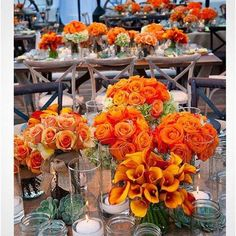 Rustic but elegant - orange roses, calla lilies and succulents top wood tables ~ Revelry Event Designers