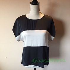 Black and White Vince Camuto Top Like new. Soft and silky top. Rayon back gives a comfortable fit. Front is 96% Rayon 4%Spandex. 🚫No Trades Tops Blouses
