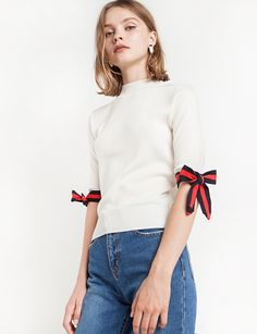 Slay your family's annual holiday photo in this striped bow tie knit top.