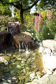 Stock & Hill Landscapes, Inc. Landscape Design - bubbling stone fountain waterfalls