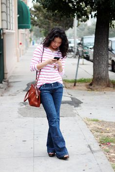 boot cut jeans + striped top + curly hair