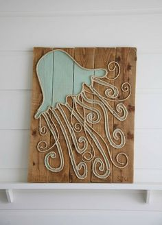 Coastal art on wood. Painted sea creatures. Sisal rope.