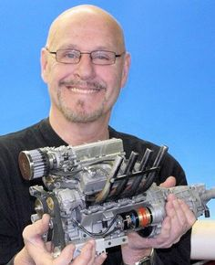 Gary Conley holding a production model of his new supercharged V8 engine (Photo: Conley Pr...