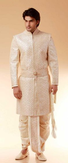 It isn't common to see a belted sherwani. Great way to add a unique touch to Indian formalwear. Also, love the dhoti!