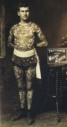 "Exhibition: 'Tattooed New York' at the New-York Historical Society, New York. ""The first of two postings on the history of tattooing and tattoo artists of New York."" https://artblart.com/2017/04/17/exhibition-tattooed-new-york-at-the-new-york-historical-society-new-york/ Photo: Unknown photographer. '""Painless"" Jack Tyron tattooed by Charlie Wagner and Lewis (Lew) Alberts' Nd"