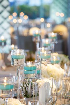 Floating candles add a special elegance to any table setting, especially in turquoise.