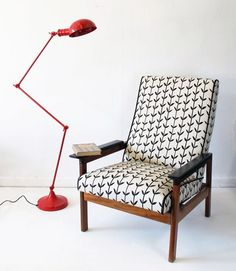 Red standing task lamp and mid century modern chair