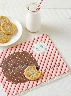 Lay out an adorable snack mat just for Santa. Fusible-web appliqués of a cookie plate and a milk glass labeled with embroidered words mark the placement for Santa's Christmas Eve must-haves.